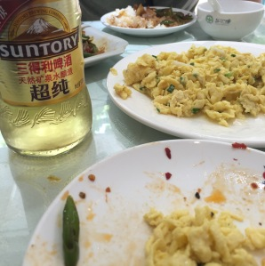 Lunch in Suzhou: pork with chili peppers and eggs with some sort of tiny shrimp (we think).